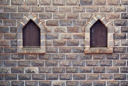 free castle windows in stone brick wall background photo