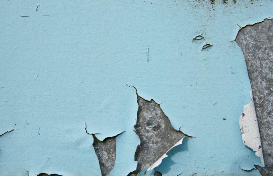 blue peeling paint on old metal background