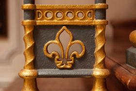 closeup image of an iron fleur-de-lis