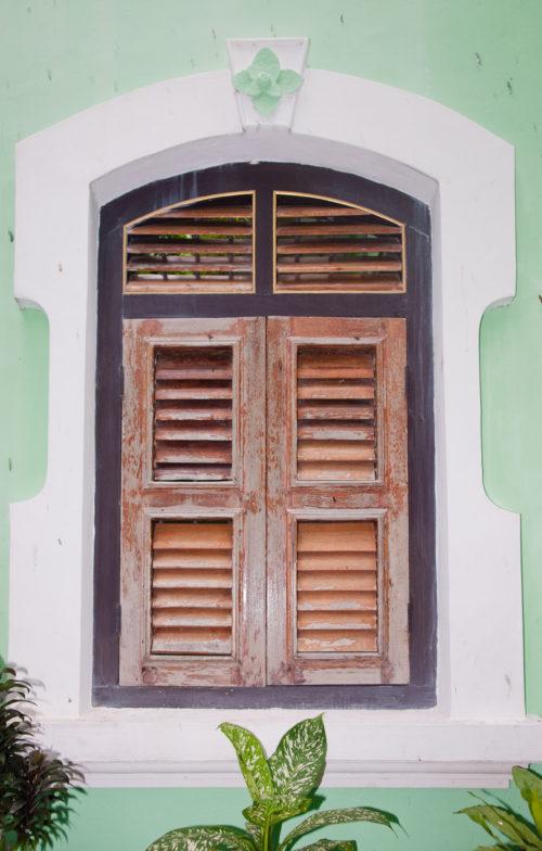 shuttered window in wall background