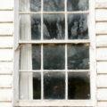 old window in wooden weatherboard wall