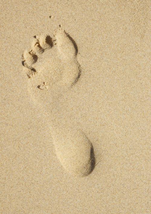 deep footprint in sand texture