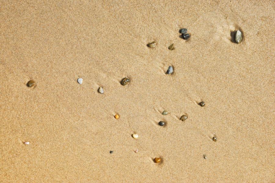 Three photos of small stones and beach sand