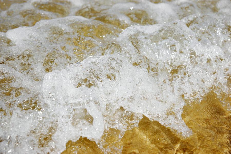 beach waves water foam closeup image