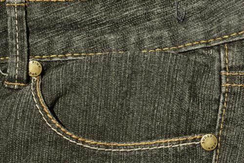 black pocket of denim jeans background