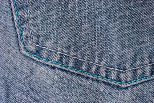 pocket of blue jeans denim texture background
