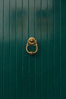 Green Door With Golden Door Knocker Free Stock Photos