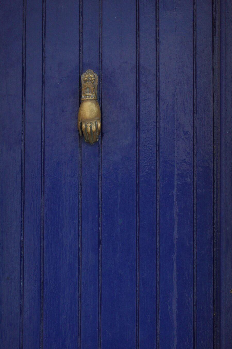 old blue door with bronze door knocker free stock photo
